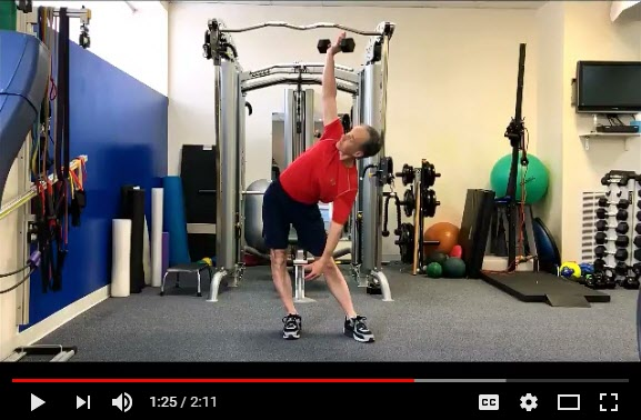 "Use the ""Windmill Stretch"" to enhance golf mobility"